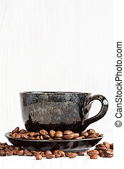 Cup of coffee on a white wood background