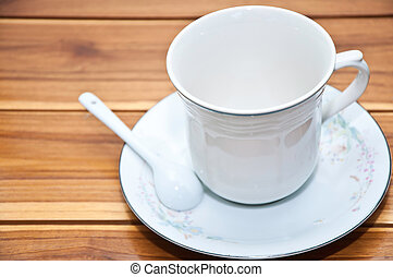 Cup of coffee on a wood background