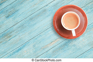 Cup of coffee on a wood table background.