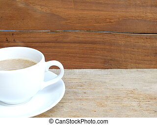 cup of coffee on a wooden table background
