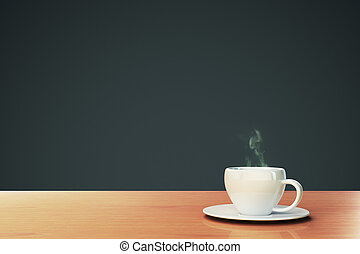 cup of coffee on a wooden table with copyspace