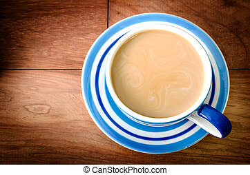 Cup of coffee on an wooden table
