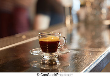 Cup of coffee on bar counter - Hot espresso in a cup on the...