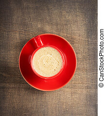 cup of coffee on dark wooden background
