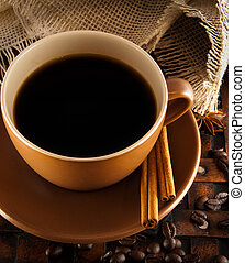 Cup of coffee on grange a background, coffee grains and...