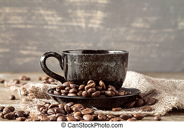 Cup of coffee on piece of sackcloth