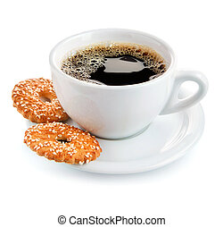 cup of coffee on saucer with biscuits