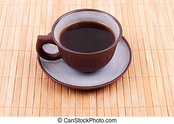 Cup of coffee on the bamboo