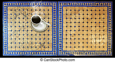 Cup of coffee on Two moroccan mosaic table