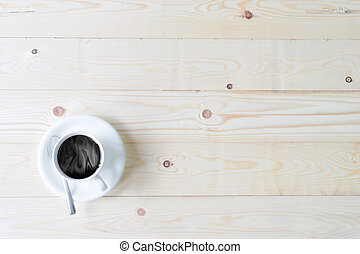 Cup of coffee on weathered table