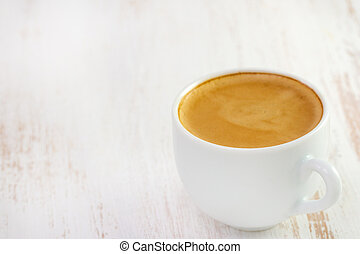 cup of coffee on white wooden table