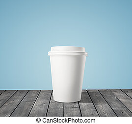 cup of coffee on wood table