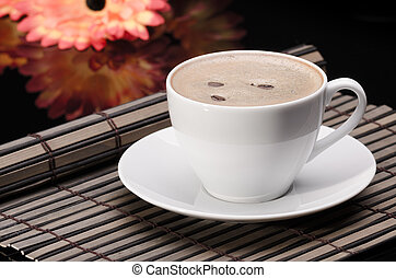 Cup of coffee on wooden surface