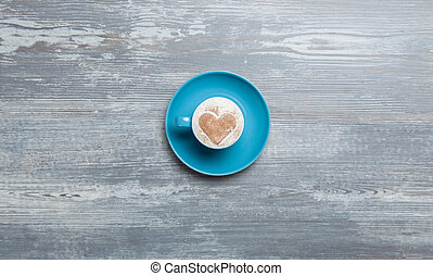 Cup of coffee on wooden table.