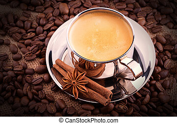 cup of Coffee on wooden vintage table with coffee bean