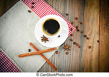 Cup of Coffee on Woody Background