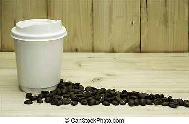 cup of coffee over vintage wood background with space for your text