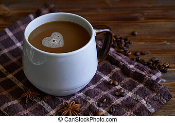 cup of coffee with a foam in the form of a heart. With love for coffee. On wooden table Copy space