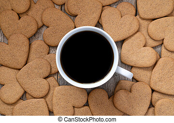Cup of coffee with a gingerbread cookies