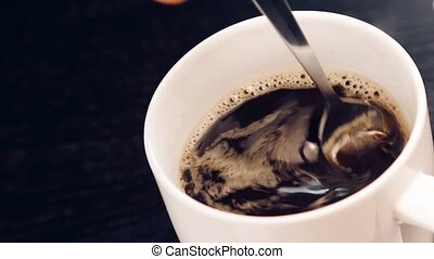 cup of coffee with adult hand
