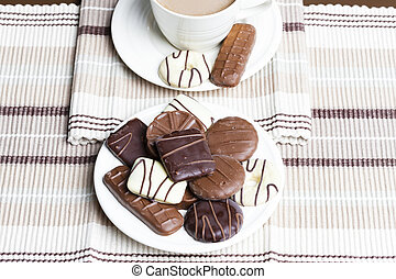 cup of coffee with biscuits