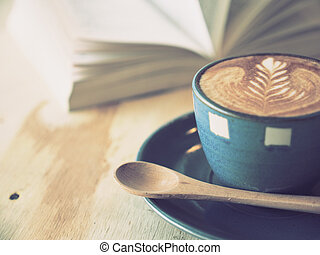 cup of coffee with book in coffee shop vintage color - cup...
