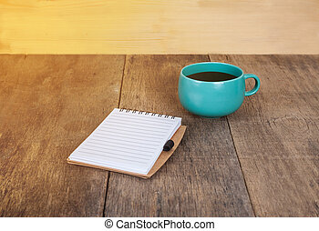 cup of coffee with book note
