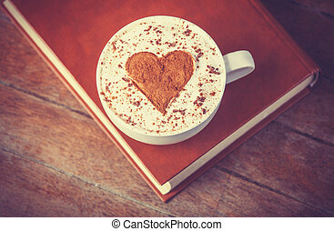 Cup of coffee with books