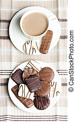 cup of coffee with chocolete biscuits