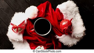 Cup of coffee with Christmas hats around - From above view...