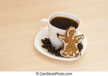 Cup of coffee with cookies on a wooden background