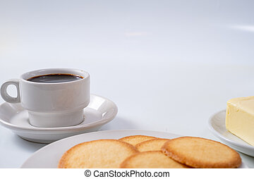 cup of coffee with cookies on background