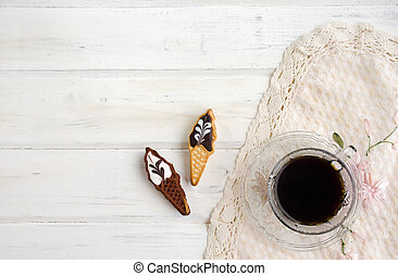Cup of coffee with cookies. on white wooden board.