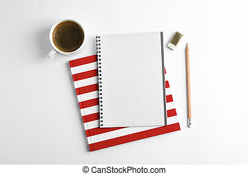 Cup of coffee with copybooks and pencil on white background, top view