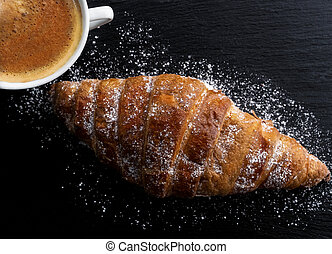 Cup of coffee with croissant for breakfast