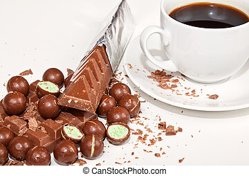Cup of coffee with diffirent types of chocolates