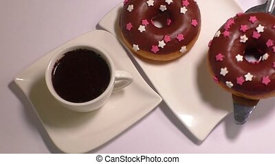 Cup of coffee with donut