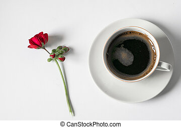 Cup Of Coffee with flower on side