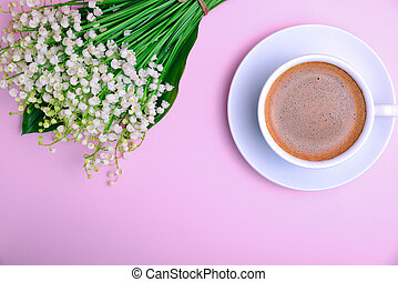 cup of coffee with foam and a bouquet