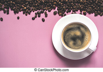 cup of coffee with foam and beans on a pink background