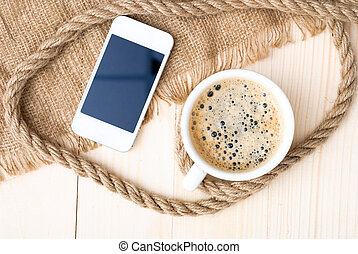 Cup of coffee with foam on wooden table