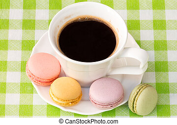 Cup of coffee with french macaroons