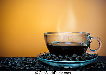 Cup of coffee with fume on a brown background