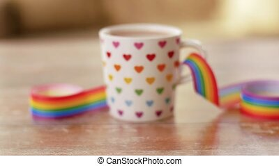 cup of coffee with gay pride awareness ribbon - homosexual...