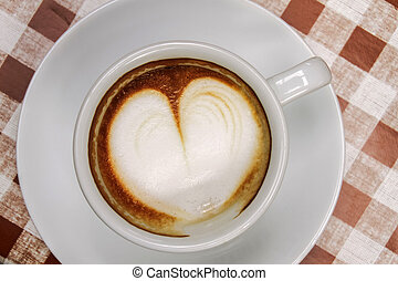 Cup of coffee with heart pattern