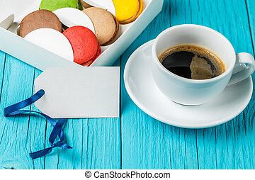 Cup of coffee with macaroon