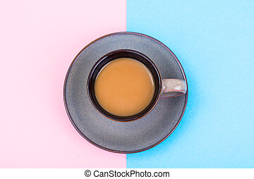 Cup of coffee with milk on pastel background