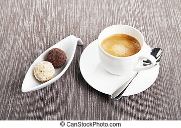 cup of coffee with mixed pralines