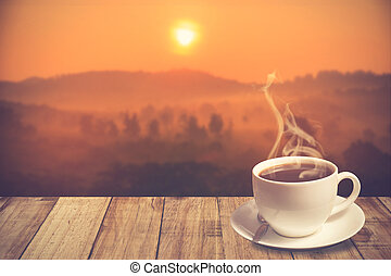 cup of coffee with mountain at morning sunrise. Vintage Color