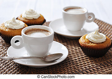 coffee with muffins - Cup of coffee with muffins on rattan...
